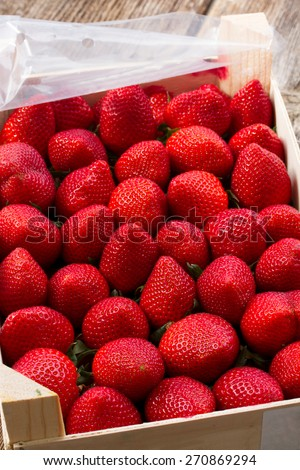 ripe of fresh red strawberry in wooden crate close up - stock photo