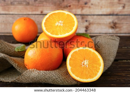 ripe orange cut in half, food closeup - stock photo