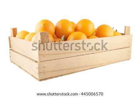 Ripe orange fruits in wooden crate isolated on white