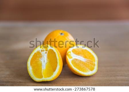 Ripe orange on a wooden background - stock photo