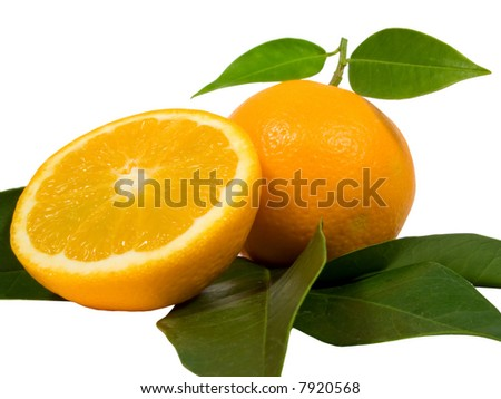 ripe orange with another orange sliced isolated in white