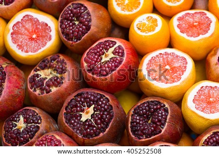 Ripe oranges and grenades for receiving freshly squeezed juice - stock photo