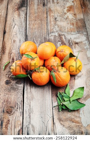 Ripe oranges on textured background.Last harvest season. - stock photo
