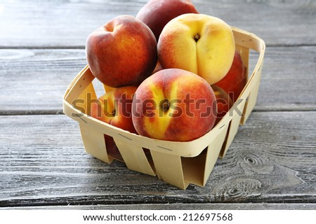 ripe peaches in wooden box, food closeup - stock photo