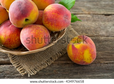 ripe peaches on wooden surface