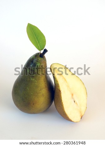 Ripe pear and one cut half on white background       - stock photo