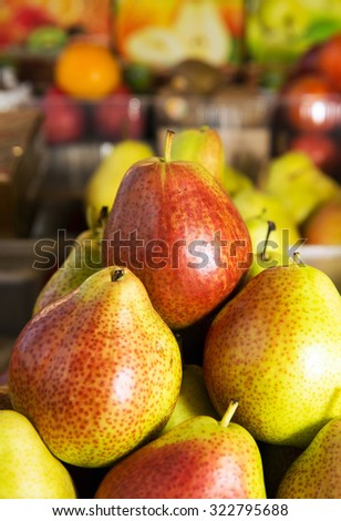 Ripe pear, background on the shop counter - stock photo