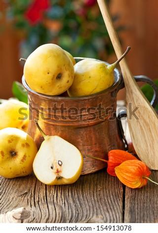 Ripe Pear in copper jug - stock photo