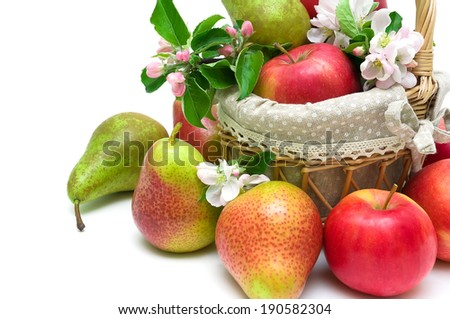ripe pears and red apples in a basket closeup on a white background. horizontal photo. - stock photo