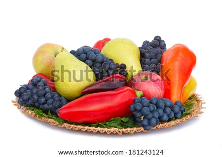 Ripe pears , apples , grapes and pepper on a platter. Presented on a white background. - stock photo