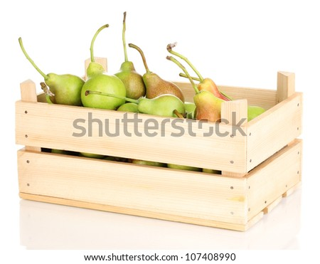 ripe pears in crate isolated on white - stock photo