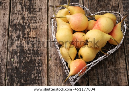 ripe pears on vintage wooden table - stock photo