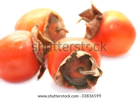 Ripe persimmons isolated on white background. - stock photo