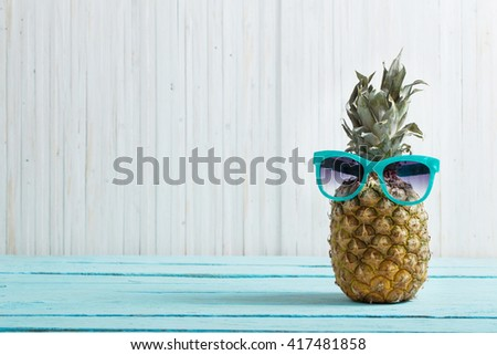 Ripe pineapple on a wooden background - stock photo
