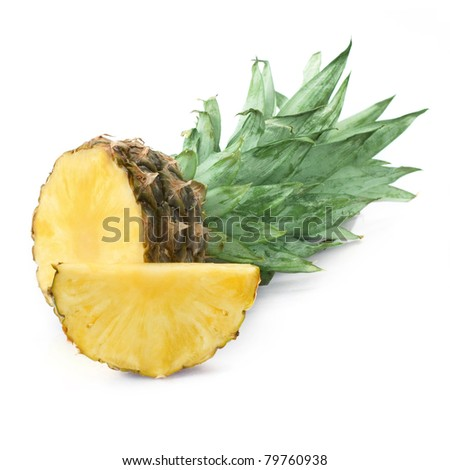 Ripe pineapple with lush green leaves