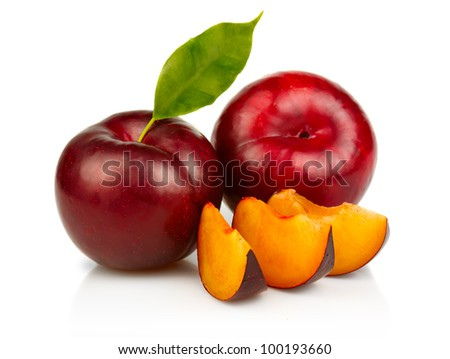 Ripe plums fruit with slices isolated on white background - stock photo