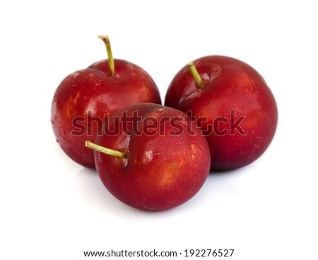 Ripe plums isolated on white background .
