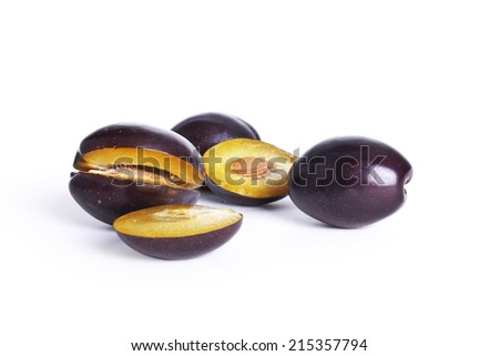 ripe Plums isolated over white background