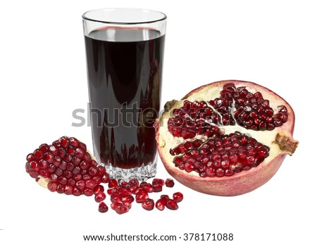 Ripe pomegranate and pomegranate juice in a glass