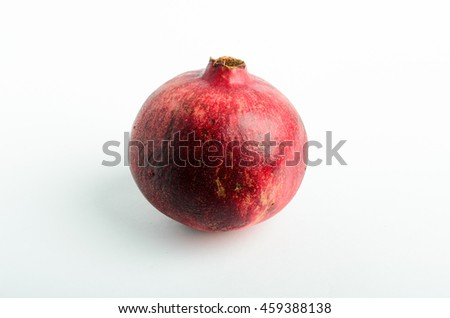 Ripe pomegranate studio shot on white background