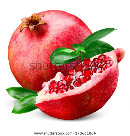Ripe pomegranate with leaves isolated on a white background - stock photo