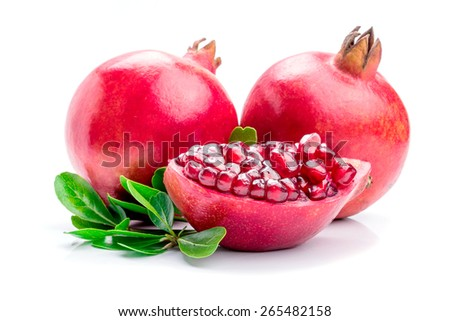 Ripe pomegranates with leaves isolated on a white background. - stock photo