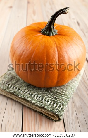 Ripe pumpkin on wooden table