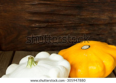 ripe pumpkin with autumn squash for Halloween