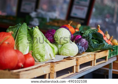 Ripe pumpkins and cabbage on farmer agricultural market in Germany. Fresh healthy bio fruits and vegetables in grocery shop or supermarket