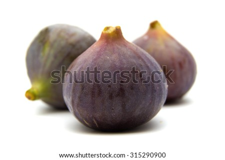 ripe purple figs isolated on white background - stock photo