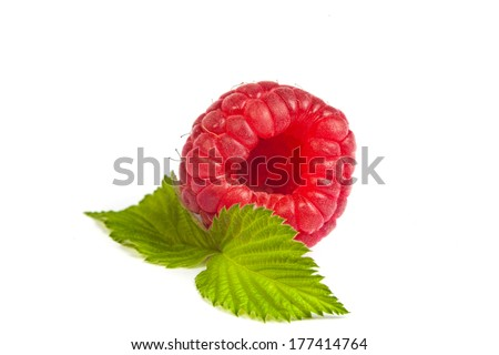 Ripe rasberry with green leaf on white background. Close up macro shot. Image was professionally retouched - stock photo