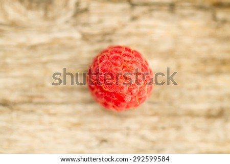 ripe raspberries closeup on wooden background, top view - stock photo
