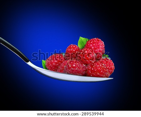ripe raspberries in a spoon - stock photo