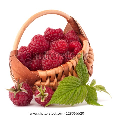 Ripe raspberries in basket isolated on white background cutout - stock photo