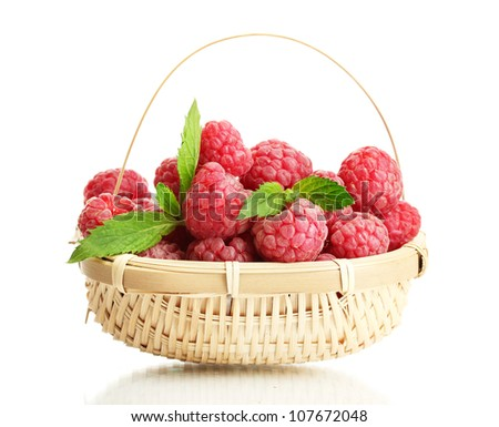 ripe raspberries in basket with mint  isolated on white - stock photo
