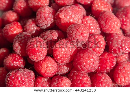 Ripe raspberries on a plate. Selective soft focus