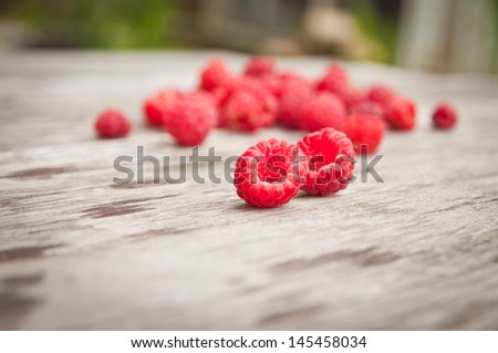 ripe raspberry on a wooden background - stock photo
