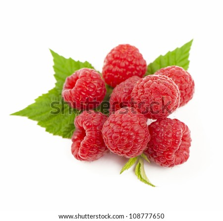 Ripe raspberry with green leaf on white background - stock photo