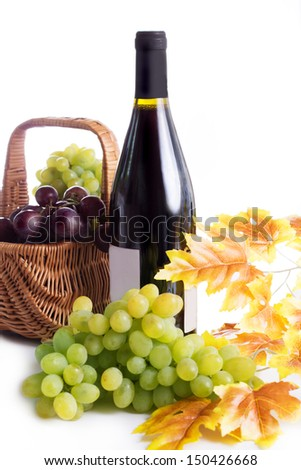 Ripe red and dark grapes and wine in basket isolated on white - stock photo