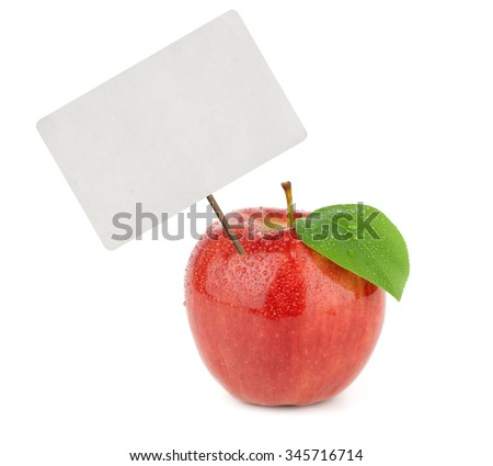 Ripe red apple with price tag isolated on white - stock photo