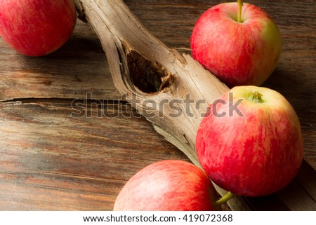 ripe red apples on a wooden background - stock photo