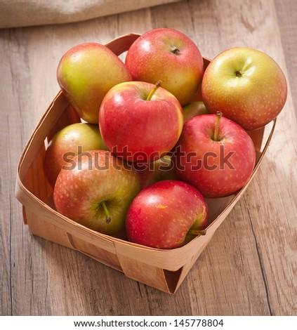 Ripe red apples on a wooden backgrounds - stock photo