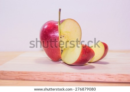 Ripe red apples on wooden - stock photo