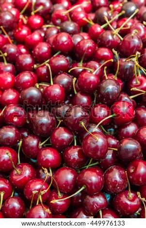Ripe red cherries in the market on the counter
