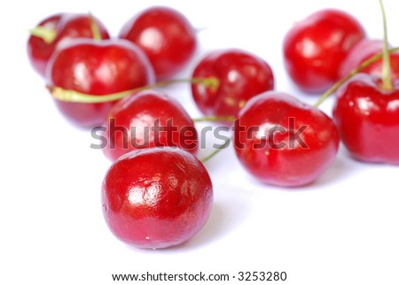 Ripe red cherries shot on a white background
