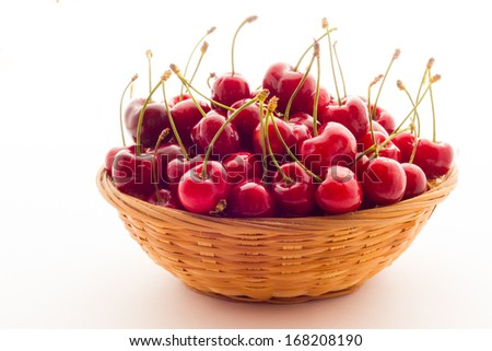 Ripe red cherry berries with white background