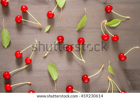 ripe red cherry on wooden background. delicious juicy fruit - stock photo