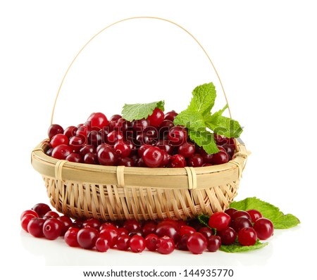 Ripe red cranberries in basket, isolated on white  - stock photo