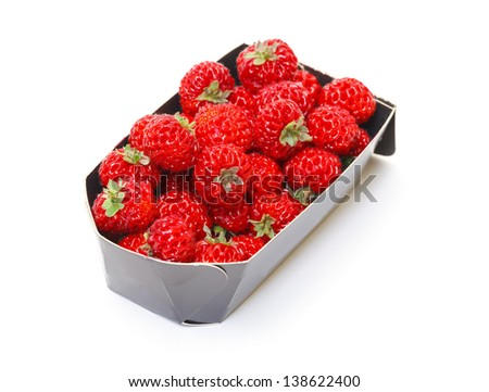 Ripe Red strawberries in paper box, on white background - stock photo