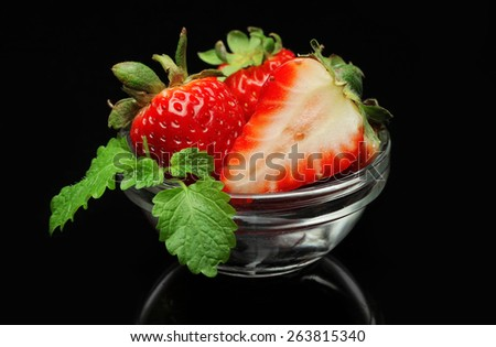 ripe red strawberries on a black background - stock photo